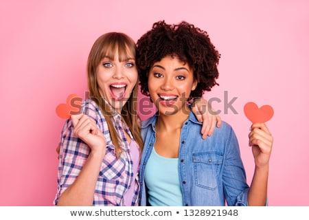 Afro girl in red checkered shirt. Stock photo © NeonShot