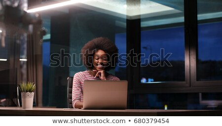 Young woman using laptop in night Stock photo © dash