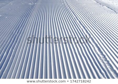 Close up of groomed corduroy covering ski trail Stock photo © MikhailMishchenko