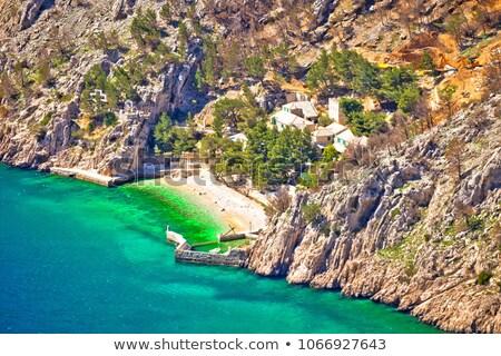 идиллический пляж каменные деревне утес горные Сток-фото © xbrchx