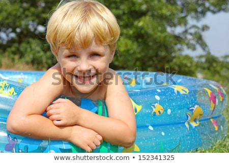 Four children playing in a kiddie pool Stock photo © IS2