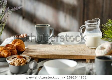 пластина круассаны деревянный стол завтрак продовольствие Сток-фото © dolgachov