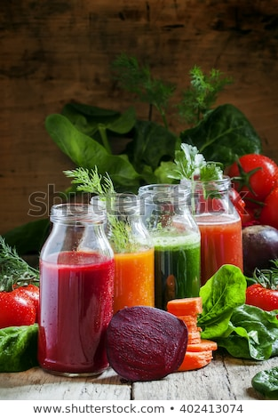 bottle of fresh organic tomato juice with fresh raw tomatoes basil and pepper in box on stone kitche stock photo © denismart