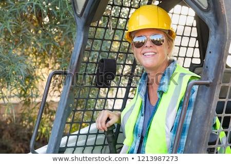 Mosolyog női munkás kicsi buldózer helyszín Stock fotó © feverpitch