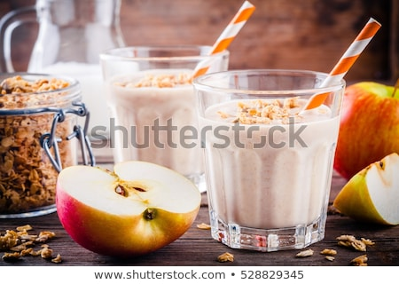 Smoothie with oat or oatmeal, banana and  red apples Stock photo © Illia