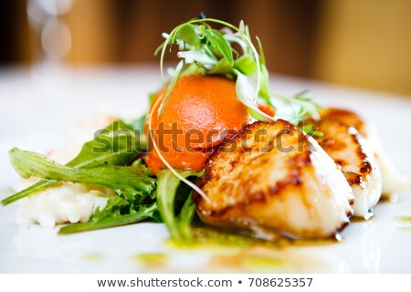 Prawns and scallops on plate Stock photo © bluering