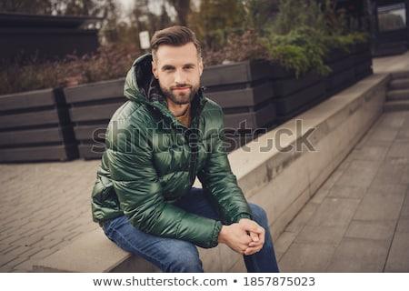 魅力的な 男 コート 座って 通り ラップトップを使用して ストックフォト © deandrobot