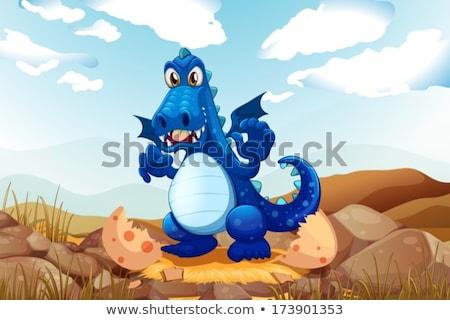 Stock photo: Blue dragon hatching egg on grass