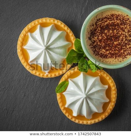 dark chocolate and lemon tarts with cappuccino stock photo © boggy
