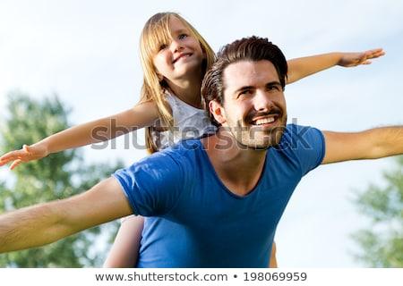 Happy fathers day scene. Family hug Stock photo © Imaagio