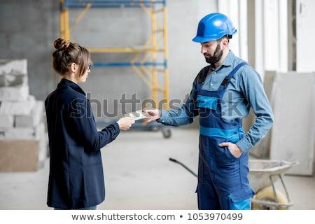 építőmunkás üzletasszony kereset fehér nő férfi Stock fotó © vladacanon