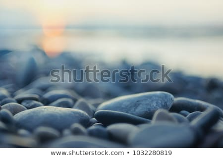 sunset landscape with beach sun and stones at sea shore stock photo © vapi