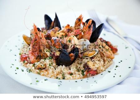 Finom tengeri hal rizottó garnélák parmezán sajt petrezselyem Stock fotó © karandaev