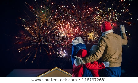 family together celebrate new year and look up stock photo © robuart