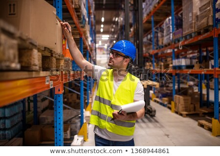 Workers checking inventory of warehouse Stock photo © Kzenon