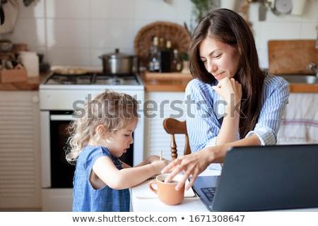 Feliz feminino freelance xícara de café trabalhando laptop Foto stock © dashapetrenko