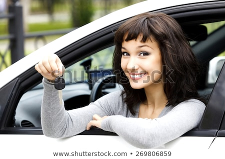pretty girl in a car showing the key stock photo © nobilior