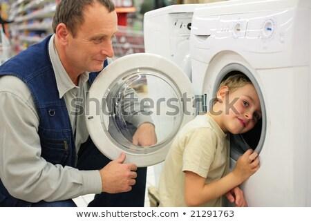 Man looks at washing machine in store, boy glances inward it Stock photo © Paha_L