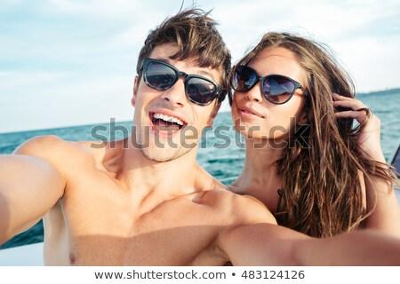 good looking couple by the sea stock photo © konradbak