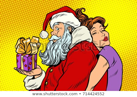 Santa Woman Holding A Present Box At Back Stock fotó © studiostoks