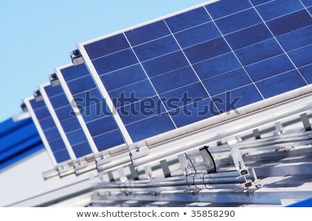 Rows Solar Panels Array Roof Blue Sky Background Stock photo © Qingwa