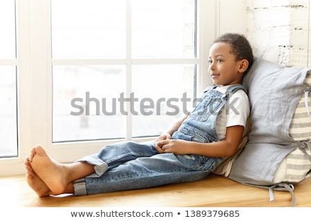Boy in the room, playing happily. stock photo © justinb