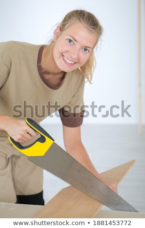Builder smiling with saw. Stock photo © photography33