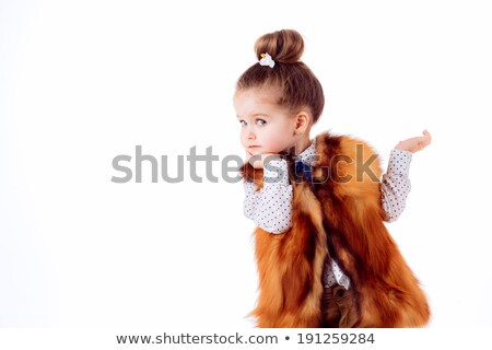 Smiley little girl in winter coat stock photo © photography33
