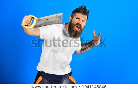 A carpenter with a handsaw. Stock photo © photography33