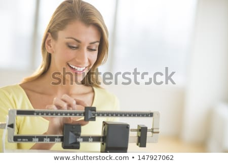 a blonde woman weighing herself Stock photo © photography33