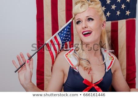 Pin Up Girl in Studio With American Flag Stock photo © tobkatrina