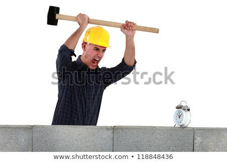 Tradesman about to smash an alarm clock Stock photo © photography33