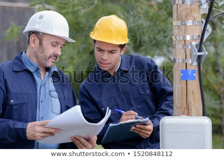 Two male electrical engineers  checking power supply Stock photo © photography33