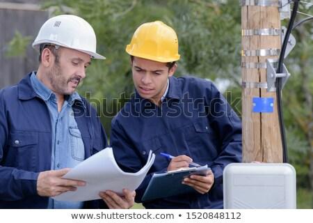 Deux Homme électrique ingénieurs source de courant terre Photo stock © photography33