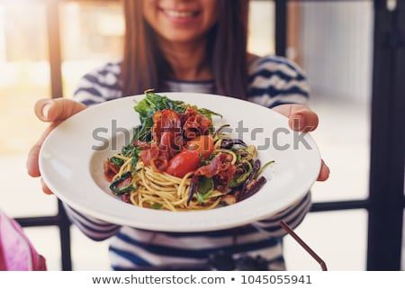 Woman holding uncooked spaghetti Stock photo © photography33