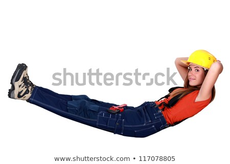 Tradeswoman lying in an invisible hammock Stock photo © photography33