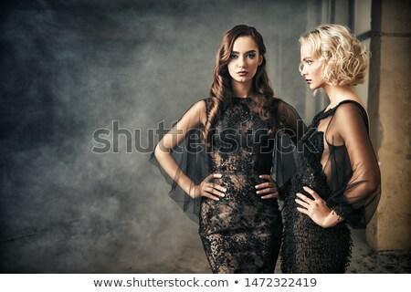 Two blonde women in evening dresses. Stock photo © Pilgrimego
