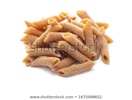Closeup of uncooked wholewheat italian pasta - penne Stock photo © shutswis