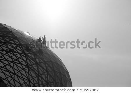 Limpieza espejo vidrio cúpula edificio escalada Foto stock © lunamarina