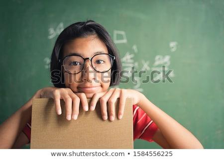 little girl raising her hand stock photo © soupstock