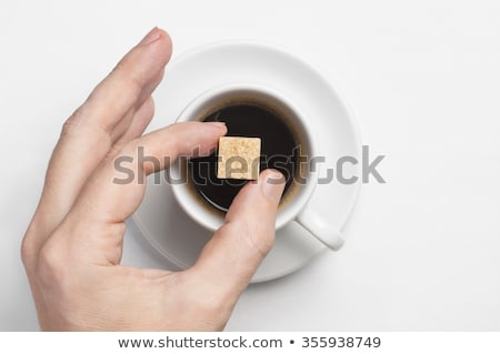 Brown sugar cubes and a cup Stock photo © marekusz