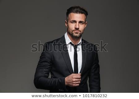 Knap zakenman poseren jonge naar camera Stockfoto © NeonShot
