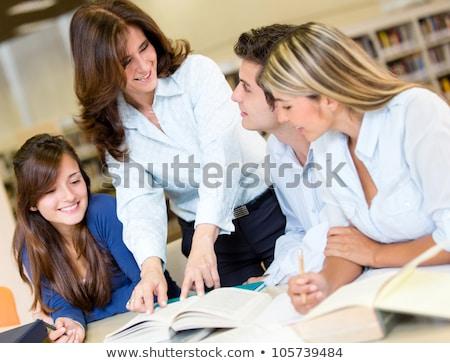 Güzel öğretmen kütüphaneci olgun büro okuma Stok fotoğraf © lisafx