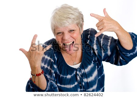 Mature woman sticking out her tongue Stock photo © bmonteny
