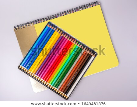Multi color pencils and sharpen on sketchbook  Stock photo © nalinratphi