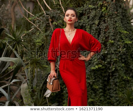 elegancki · brunetka · czerwona · sukienka · biały · model · piękna - zdjęcia stock © wavebreak_media