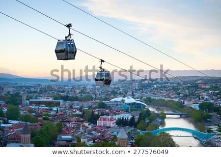 Grúzia sziluett naplemente felső kilátás város Stock fotó © joyr