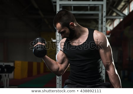 Jonge man biceps concentratie bodybuilder Stockfoto © Jasminko
