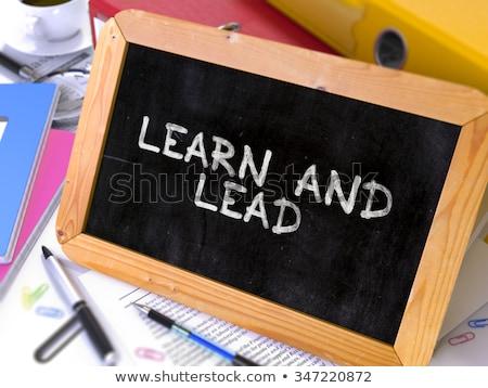 learn and lead   chalkboard with motivation quote stock photo © tashatuvango