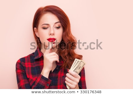 Portrait of a redhead woomen in tartan  Stock photo © Massonforstock